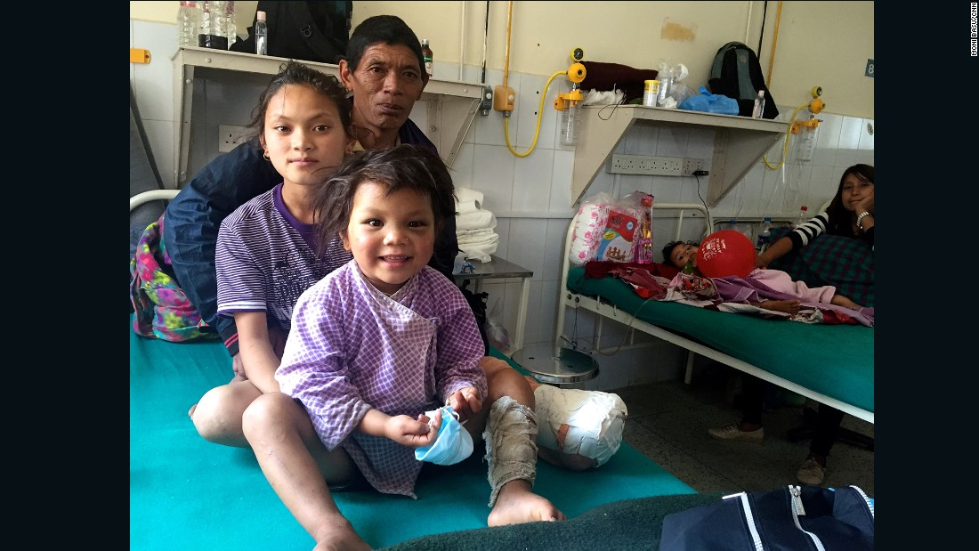 Maya with her father, Bhim Bahardur Gurung, and cousin Manisha at the Tribhuban University Teaching Hospital.