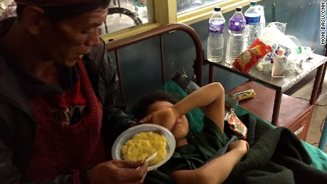 Maya's father tries to feed her lentils and rice, but in the days after the amputation she had little appetite and cried all the time.