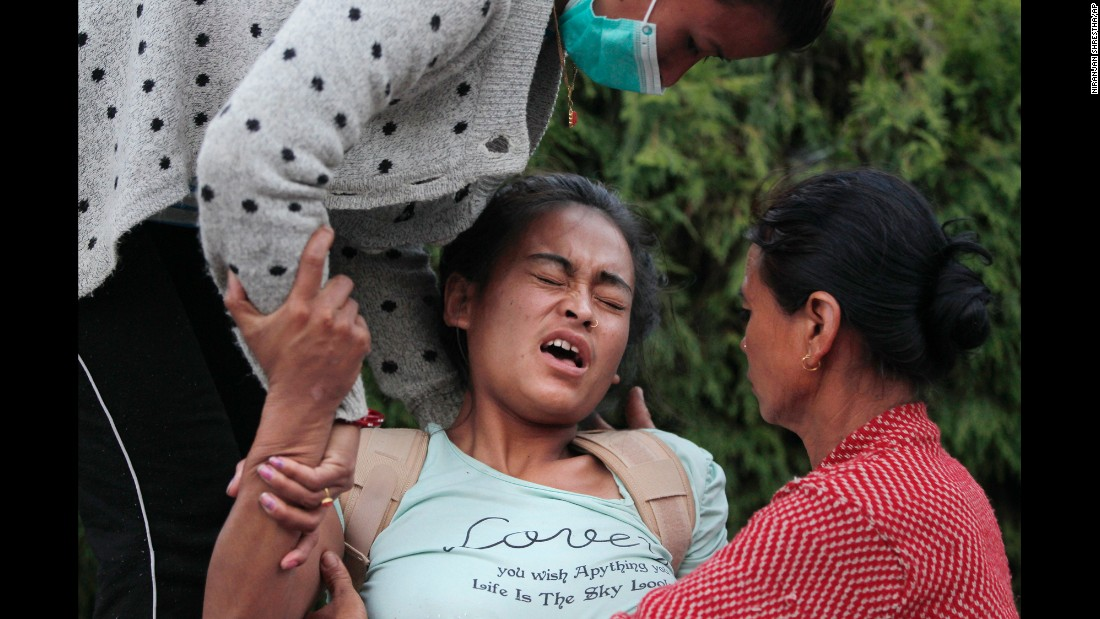 A woman tries to sit up at a hospital in Kathmandu on May 12.
