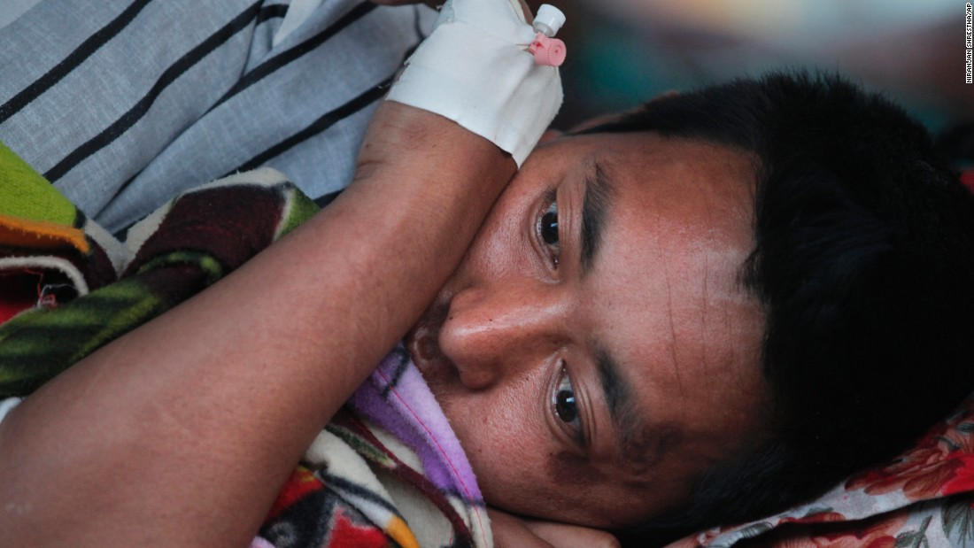 An injured man rests at a hospital in Kathmandu on May 12.