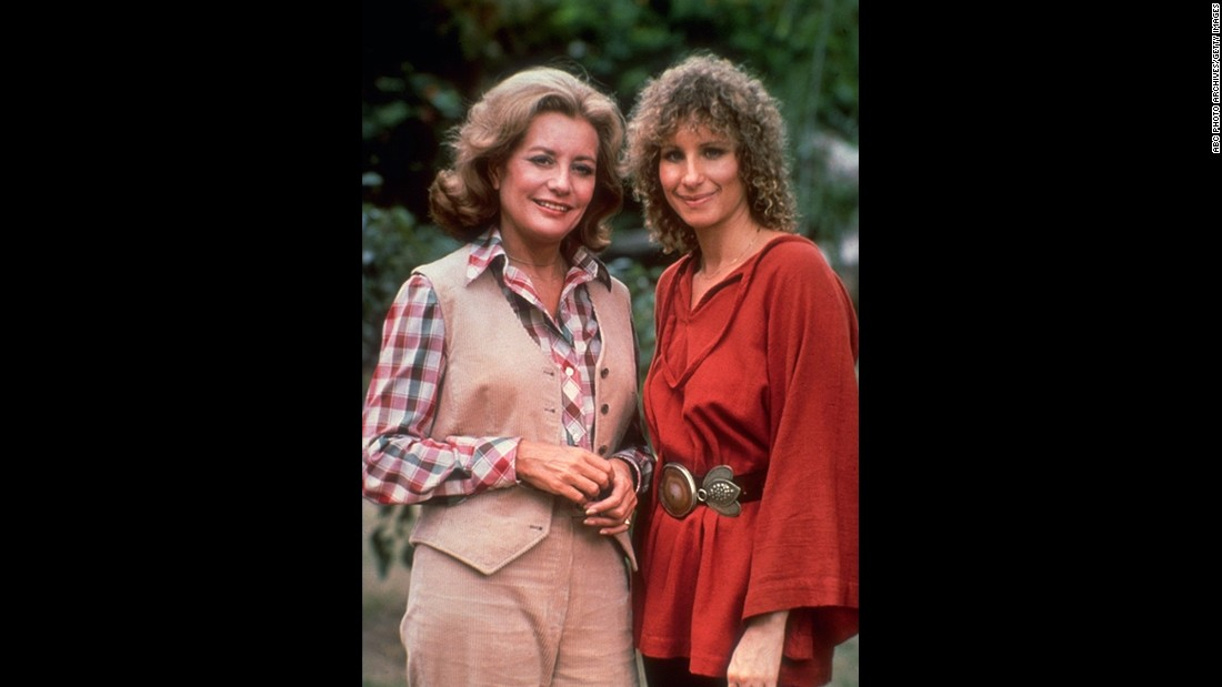 "In October 1976, Barbara Walters, seen at left with actress Barbra Streisand, became the first woman to co-anchor a major network evening newscast. ABC made history before she even went on air, signing Walters to a $1 million annual contract to make her the highest-paid journalist at that time. She only co-anchored the show for a year and a half, but she would go on to host ABC shows such as ""20/20,"" ""The View"" and ""Barbara Walters Specials"" until her retirement in 2014."