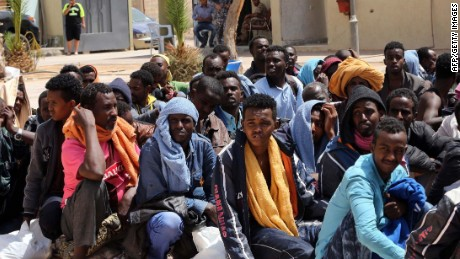 Migrants from sub-Saharan Africa sit at a center for illegal migrants in the al-Karem district of the Libyan eastern port city of Misrata on May 9, 2015, as they wait to be transported to a different detention center. Mohammed Khalifa al-Guwail, the acting prime minister of Libya's disputed government, urged European Union countries to help his administration tackle illegal immigration by sending boats for the coastguard. AFP PHOTO / MAHMUD TURKIAMAHMUD TURKIA/AFP/Getty Images