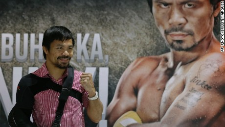 Filipino boxer and Congressman Manny Pacquiao poses for the media following a news conference upon arrival Wednesday, May 13, 2015 at the Ninoy Aquino International Airport at suburban Pasay city south of Manila, Philippines.
