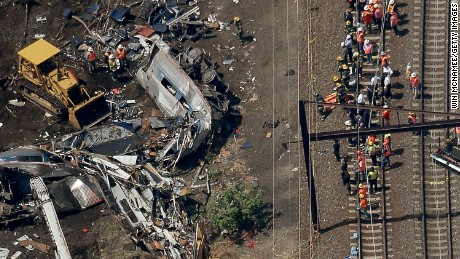 PHILADELPHIA, PA - MAY 13:  Investigators and first responders work near the wreckage of an Amtrak passenger train carrying more than 200 passengers from Washington, DC to New York that derailed late last night May 13, 2015 in north Philadelphia, Pennsylvania. At least five people were killed and more than 50 others were injured in the crash.  (Photo by Win McNamee/Getty Images)