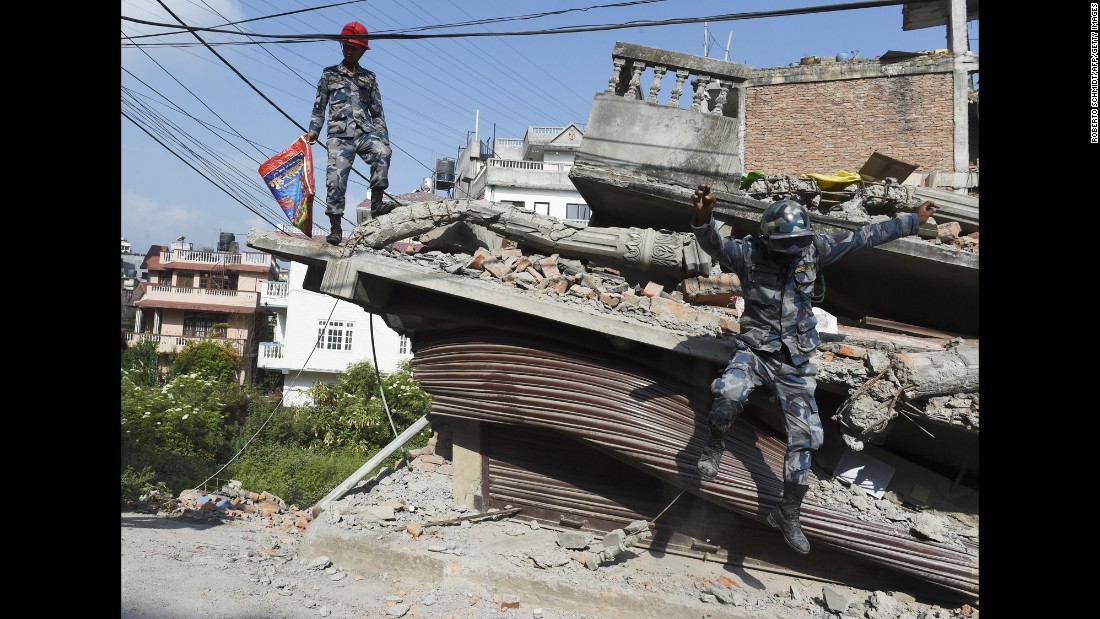Nepali rescue team members work at a collapsed building in Kathmandu on May 14.