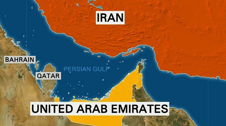 Iranian boats fire shots at a ship in the Persian Gulf