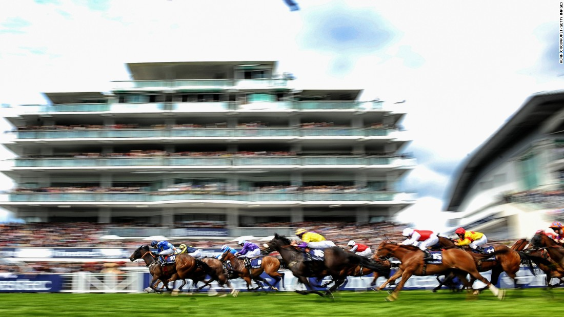 The grandstand is a mere blur as the race action hots up on the turf.