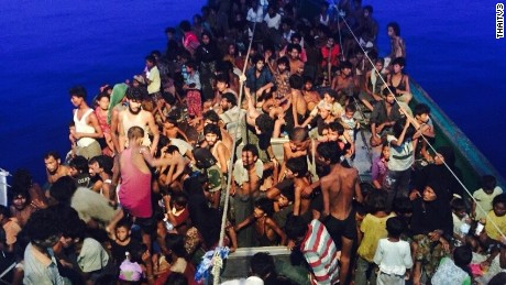 Hundreds of desperate Rohingya migrants are packed on a wooden boat that was spotted off Thailand's coast Thursday, May 14, 2015.