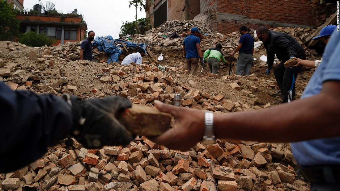 "People collect bricks from the ruins of buildings in Bhaktapur, Nepal, on Friday, May 15. The region was struck with a magnitude-7.3 earthquake on Tuesday, May 12, just 17 days after a <a href=""http://www.cnn.com/2015/04/25/world/gallery/nepal-earthquake/index.html"" target=""_blank"">magnitude-7.8 quake</a> left thousands dead."