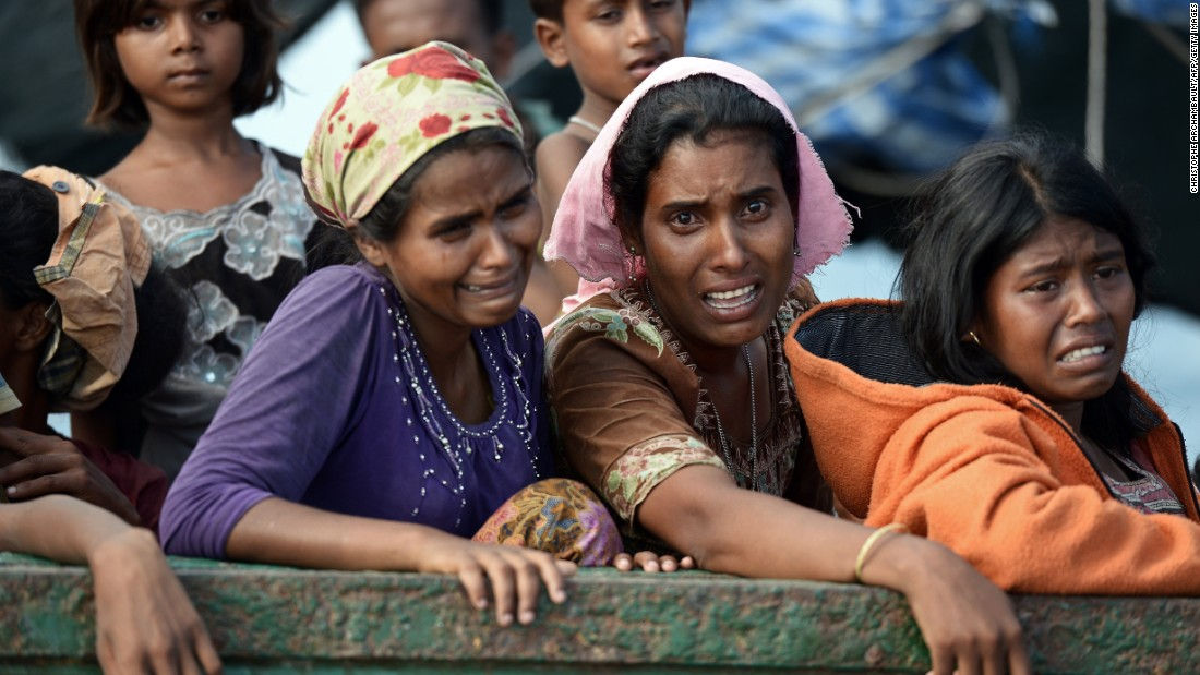Rohingya migrant women cry as they sit on a boat adrift. Many on board the rickety ship were women and young children, without food or water, looking for a safe harbor to take them in.