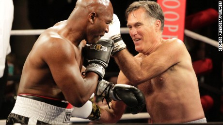 Caption:SALT LAKE CITY, UT - MAY 15: Mitt Romney and Evander Holyfield fight in a charity boxing event on May 15, 2015 in Salt Lake City, Utah. The event was held to raise money for 'Charity Vision' a charity that aims to restore sight to the blind and visually impaired. (Photo by George Frey/Getty Images)