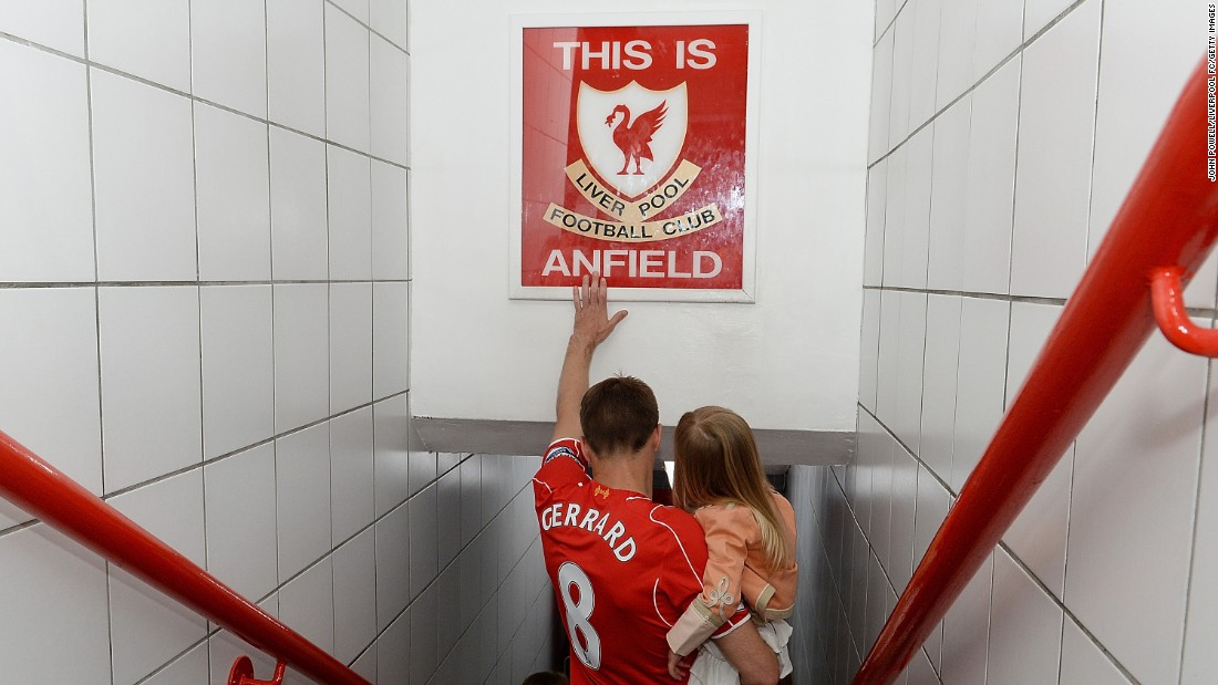 "Liverpool's Steven Gerrard touches the famous ""This is Anfield"" sign before <a href=""http://www.cnn.com/2015/05/16/football/football-gerrard-liverpool-anfield/"" target=""_blank"">playing his final home match</a> Saturday, May 16, in Liverpool, England. Gerrard's career will continue in the United States, where he'll play for the Los Angeles Galaxy. Gerrard played 17 seasons for Liverpool, appearing in more than 700 matches."