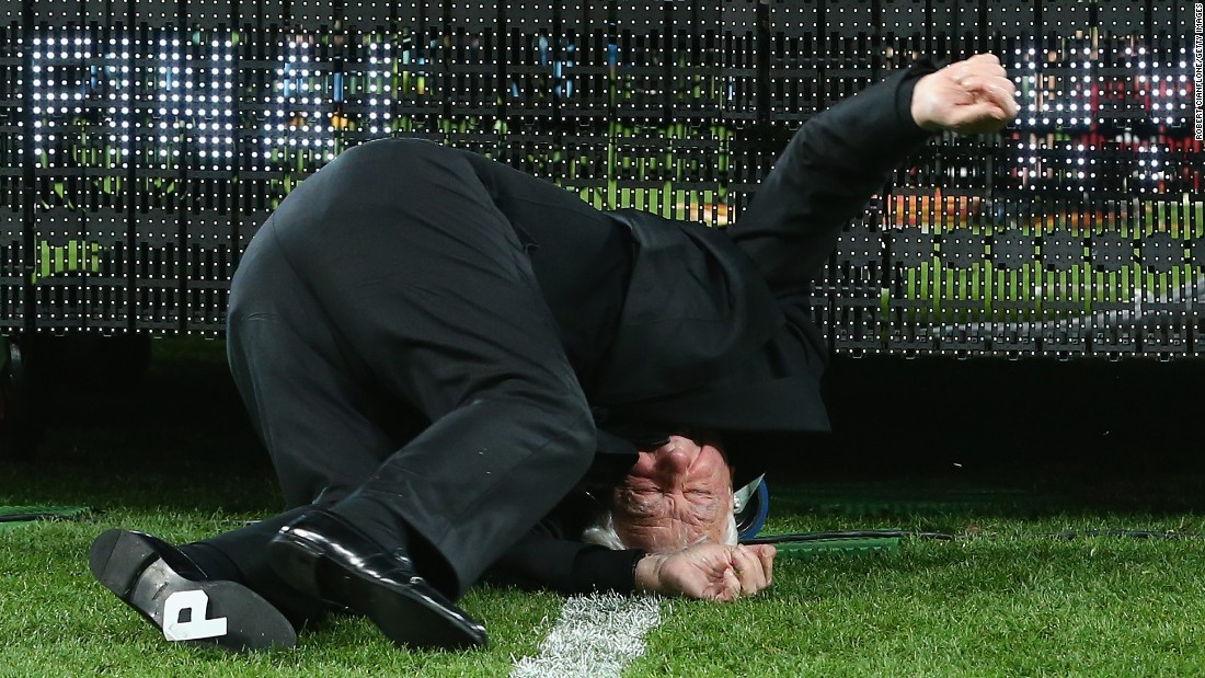 Frank Lowy, chairman of the Australian Football Federation, falls off the stage while presenting the Melbourne Victory with the Grand Final trophy on Sunday, May 17. The 84-year-old was not seriously hurt.