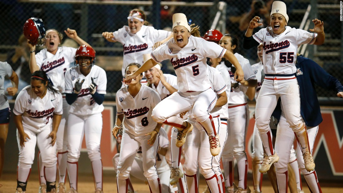 Arizona's softball team celebrates a game-tying home run by Chelsea Goodacre during an NCAA tournament game Sunday, May 17, in Tucson, Arizona. The Wildcats advanced to the next stage of the tournament by defeating Minnesota 7-6 in eight innings.