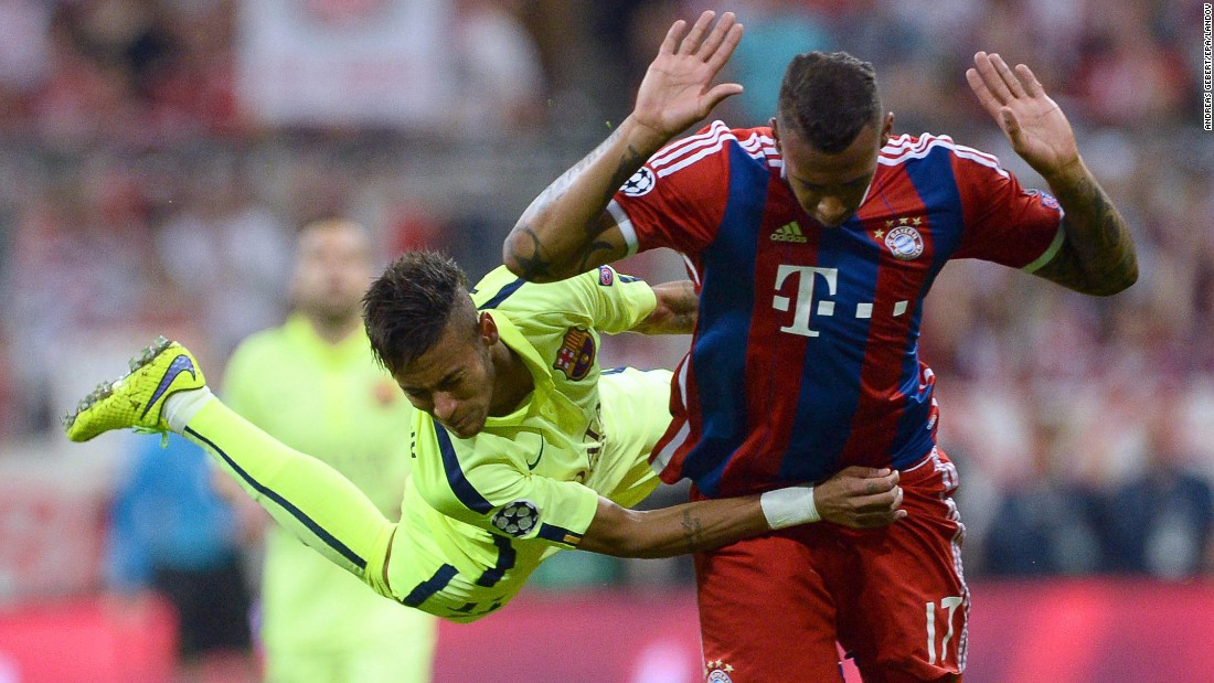 Barcelona's Neymar, left, holds onto Bayern Munich's Jerome Boateng on Tuesday, May 12, during the second leg of their UEFA Champions League semifinal. Bayern won the match 3-2, but Barcelona advanced to the tournament final with an aggregate score of 5-3.
