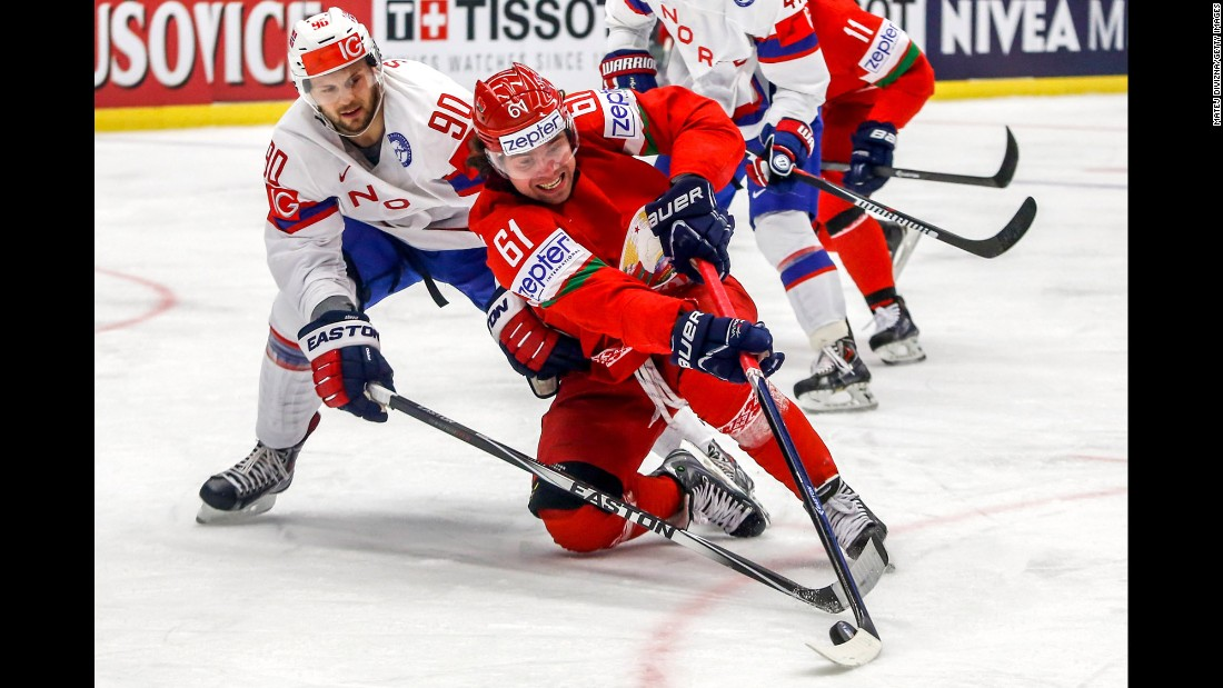 Norway's Daniel Sorvik, left, and Belarus' Andrei Stepanov battle for the puck during a game at the Ice Hockey World Championship on Tuesday, May 12.