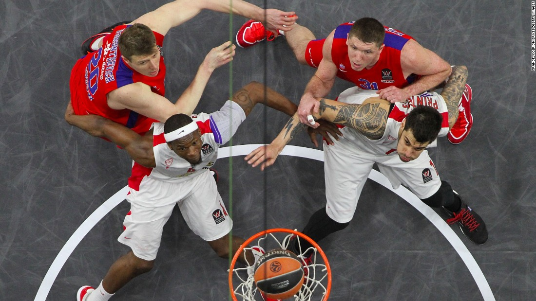 Olympiacos players box out two players from CSKA Moscow during their Euroleague Final Four game Friday, May 15, in Madrid. Olympiacos won 70-68 but lost in the final to Real Madrid.