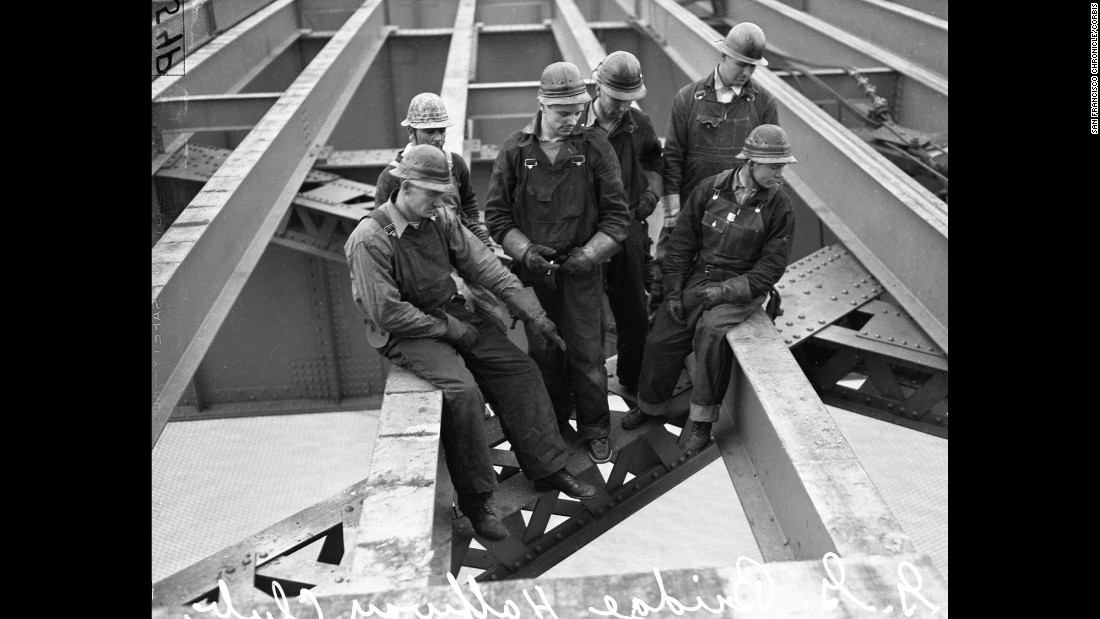 "This portrait shows members of the bridge's ""Halfway to Hell Club"" -- workers who had tumbled off the bridge but were saved by the safety netting below. Despite the netting, 11 workers died during the bridge's construction. Ten of them perished when a section of scaffold fell through the netting."