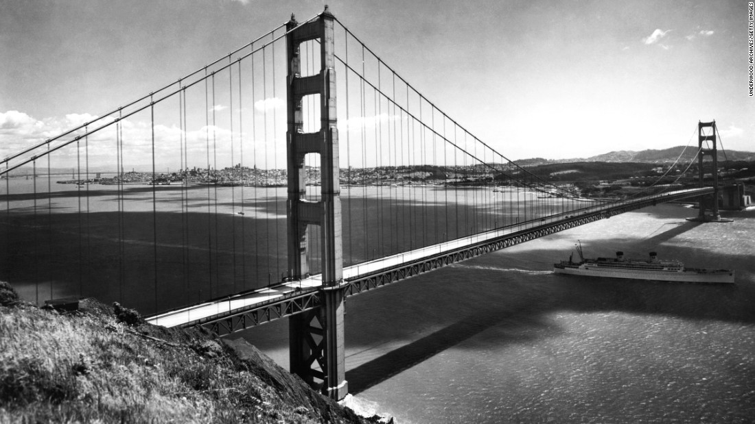 "A Matson Liner passes under the Golden Gate Bridge on its way out to sea in the late 1930s. The American Society of Civil Engineers named the bridge one of the ""Wonders of the Modern World."" Since its completion, the bridge has been crossed by more than 2 billion vehicles and closed because of weather conditions only three times."