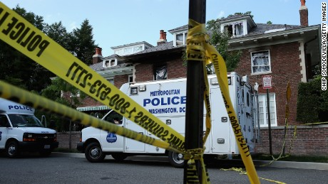 Caption:WASHINGTON, DC - MAY 19: District of Columbia Metropolitan Police maintain a perimeter around the house on the 3200 block of Woodland Drive NW May 19, 2015 in Washington, DC. Firefighters discovered the bodies of Savvas Savopoulos, 46, his wife Amy, 47, their 10-year-old son Philip, and the housekeeper, Veralicia Figueroa, 57, last Thursday afternoon when they responded to a blaze at the house. Two Savopoulos daughters were away in boarding school at the time. Investigators have ruled the deaths homicides and say they could continue to collect evidence at the house for another week. (Photo by Chip Somodevilla/Getty Images)