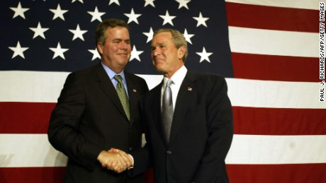 US President George W. Bush (R) shakes hands with his brother Florida Governor Jeb Bush during a fund-raising event at the PGA National Resort & Spa in Palm Beach Gardens, Florida, 08 January 2004.