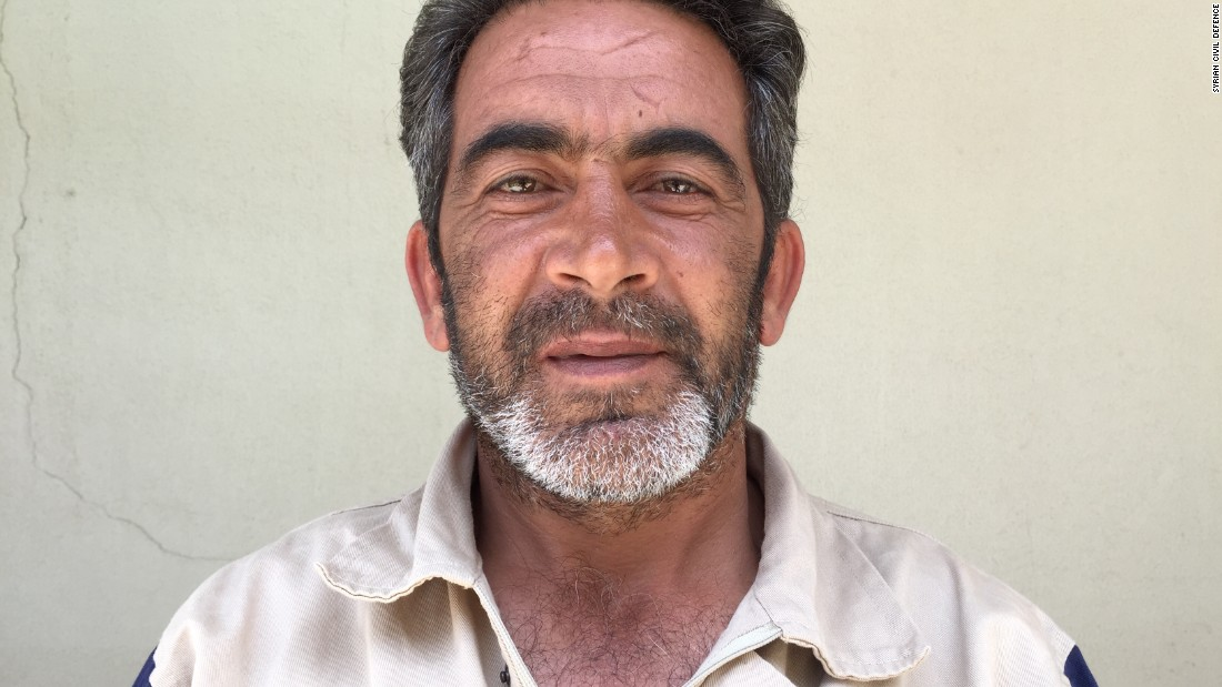 "Mohammad Ata Rashwani, 44. Hospital administration. ""We were in a village called Kastim and rescued a man whose entire lower half was buried. A missile hit a car outside the shop he was in. We took him to the hospital and he lived."" Mohammad joined the White Helmets five days after his son was killed working the very same job."