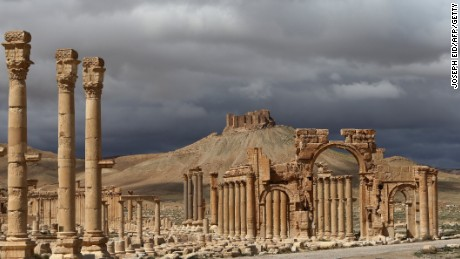 Caption:A picture taken on March 14, 2014 shows Syrian citizens riding their bicycles the ancient oasis city of Palmyra, 215 kilometres northeast of Damascus. From the 1st to the 2nd century, the art and architecture of Palmyra, standing at the crossroads of several civilizations, married Graeco-Roman techniques with local traditions and Persian influences. AFP PHOTO/JOSEPH EID (Photo credit should read JOSEPH EID/AFP/Getty Images)