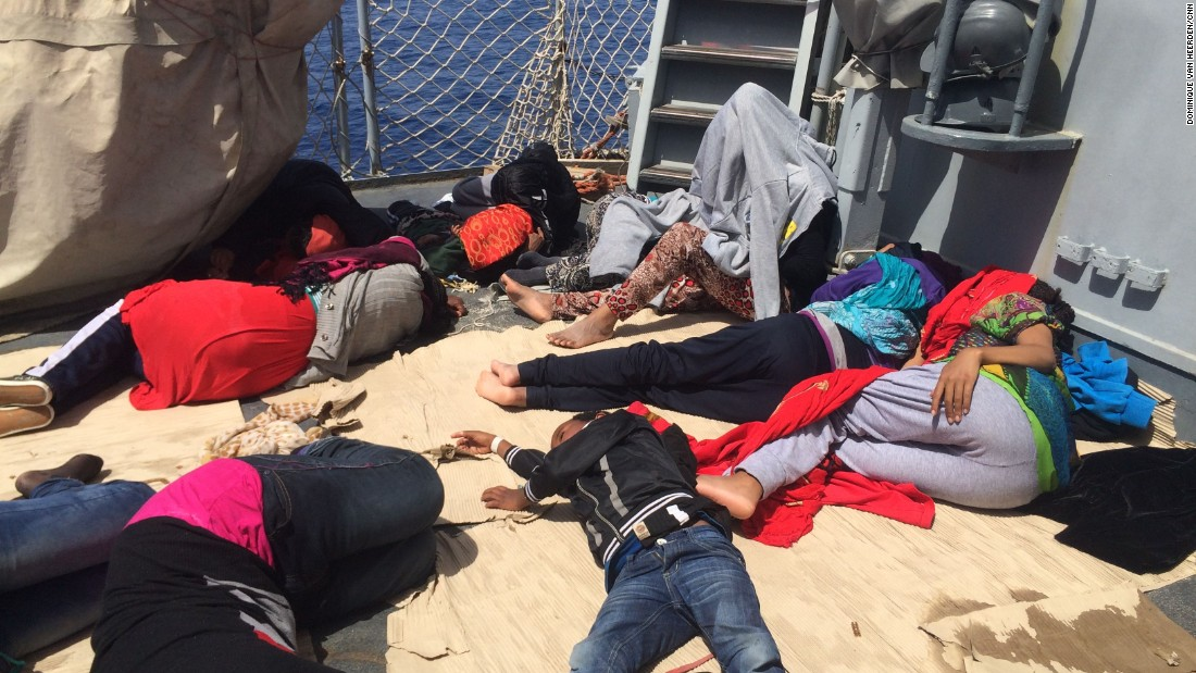 "A sigh of relief: Women and children sleep on the deck of the Sfinge, an Italian Minerva-class warship -- ""sfinge"" is Italian for ""sphinx"" -- after being rescued.<br /><br />Producer Dominique van Heerden took these photos after the CNN team helicoptered in from the Italian island of Lampedusa."