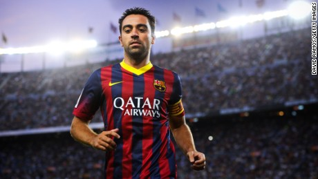 Beneath the lights of home: Xavi Hernandez in action for Barcelona at the Camp Nou.