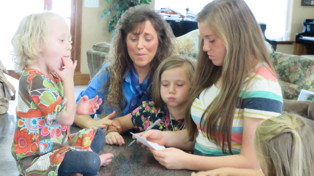 Four of the Duggar girls with their mother, Michelle.
