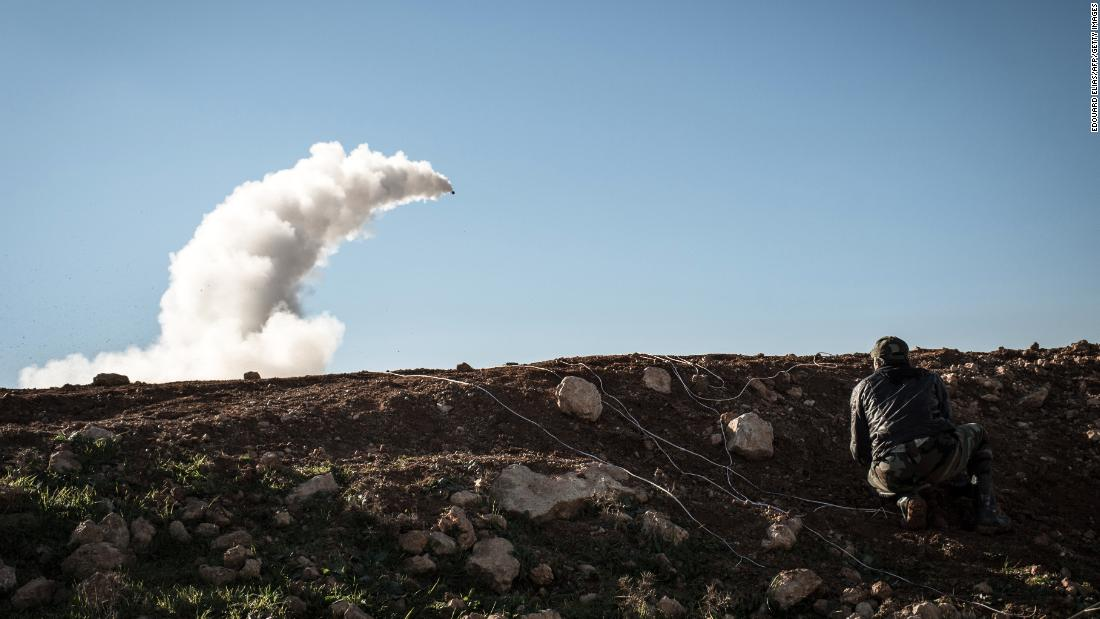 Rebels launch a missile near the Abu Baker brigade in Al-Bab, Syria, on January 16, 2013.