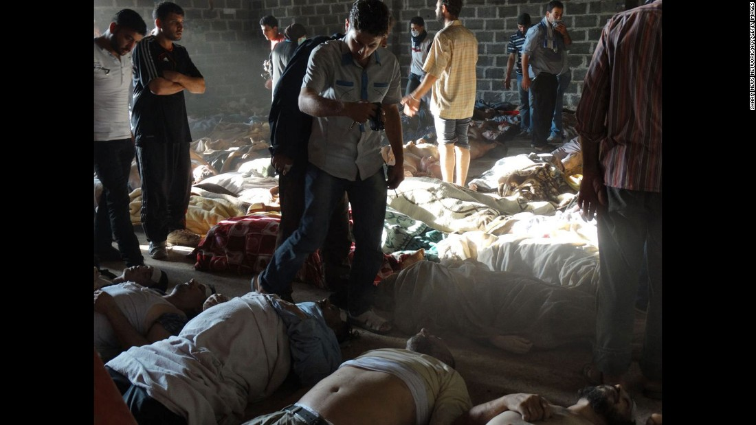 "A handout image released by the Syrian opposition's Shaam News Network shows people inspecting bodies of children and adults who rebels claim were killed in a toxic gas attack by pro-government forces on August 21, 2013. A week later, U.S Secretary of State John Kerry said U.S. intelligence information found that <a href=""http://www.cnn.com/2013/08/30/world/europe/syria-civil-war/index.html"" target=""_blank"">1,429 people were killed</a> in the chemical weapons attack, including more than 400 children. Al-Assad's government claimed that jihadists fighting with the rebels carried out the chemical weapons attacks to turn global sentiments against it."