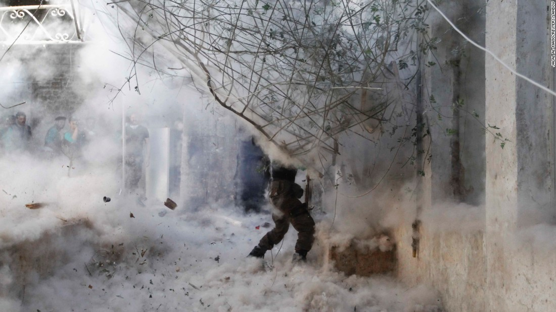 A Free Syrian Army fighter fires a rocket-propelled grenade during heavy clashes in Aleppo on April 27, 2014.