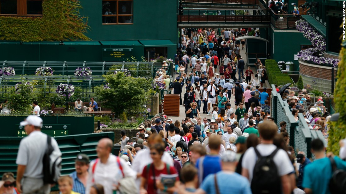 Fans throng pathways at the All England Club on day one of the 2014 tournament.