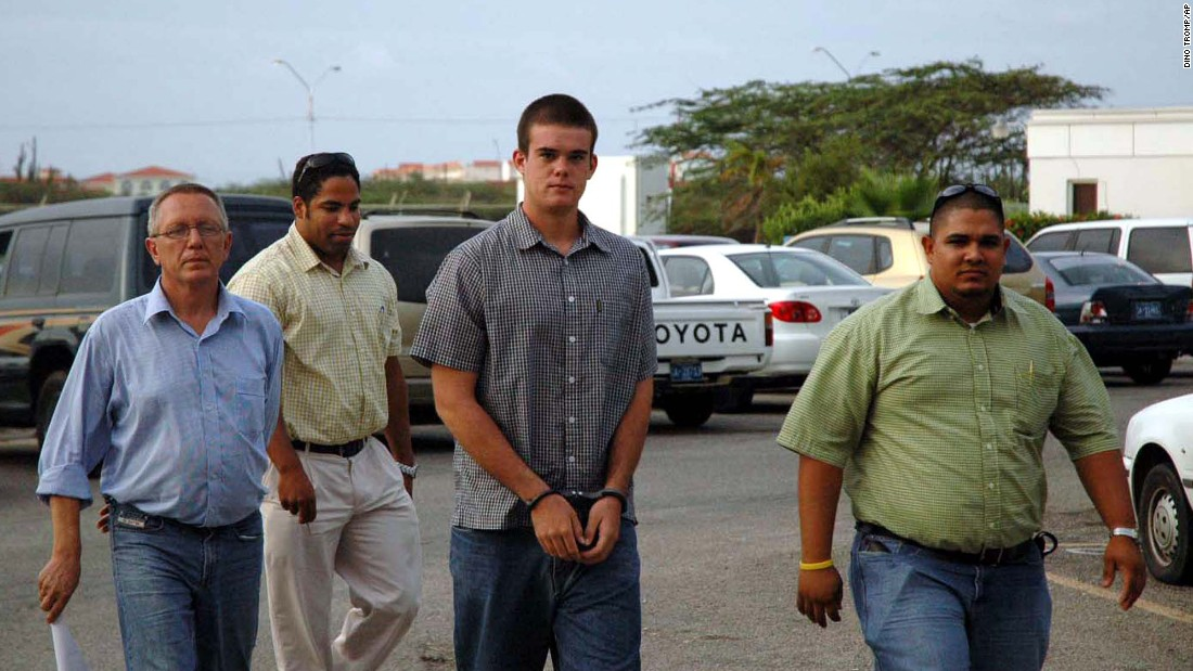 Joran van der Sloot, center, arrives at the hospital for DNA tests in July 2005, Today, van der Sloot is in prison in Peru after being convicted of murdering Stephany Flores in 2010.