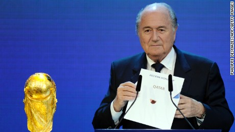 FIFA President Sepp Blatter holds up the name of Qatar during the official announcement of the 2022 World Cup host country on December 2, 2010  at the FIFA headquarters  in Zurich. South Korea, Japan, Australia, Qater and the US were all bidding to host the 2022 World Cup.  AFP PHOTO / PHILIPPE DESMAZES (Photo credit should read PHILIPPE DESMAZES/AFP/Getty Images)