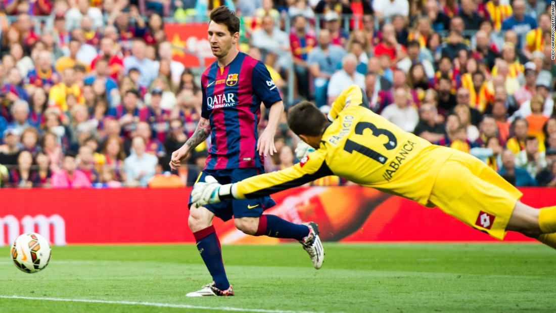 Messi scores his second goal in Barcelona's 2-2 draw with Deportivo La Coruna, taking his season tally to 56.