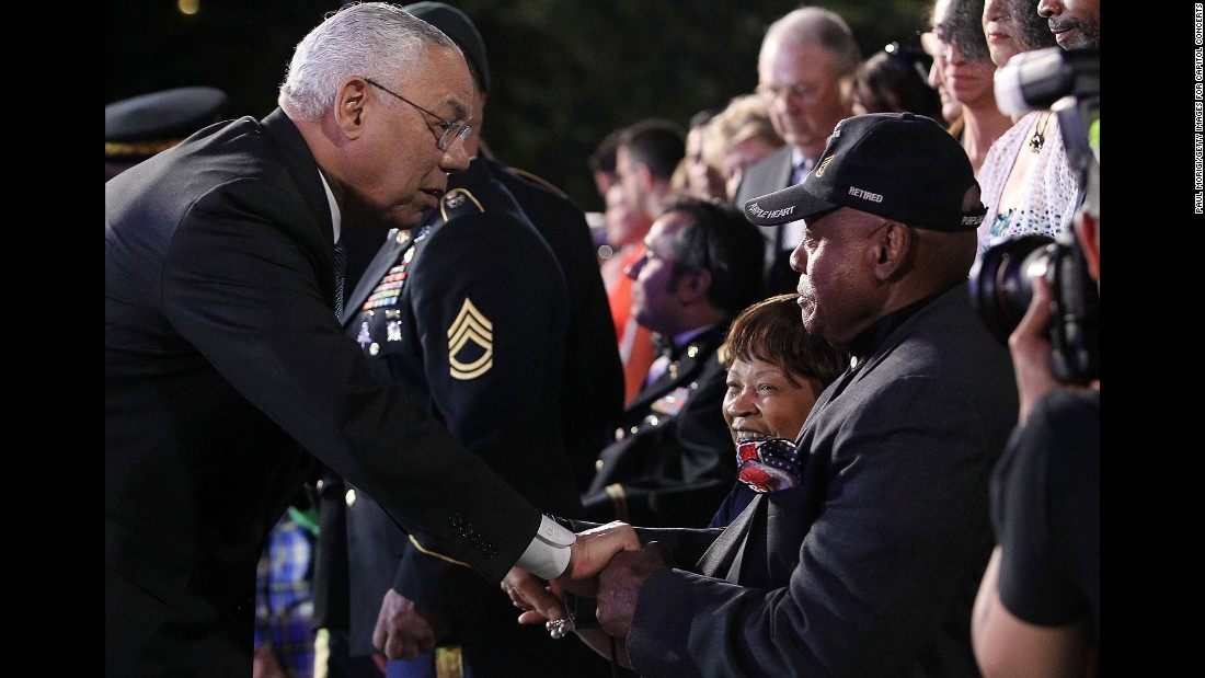 Former Secretary of State Colin Powell greets disabled veteran Ted Strong at the National Memorial Day Concert in Washington on May 24.