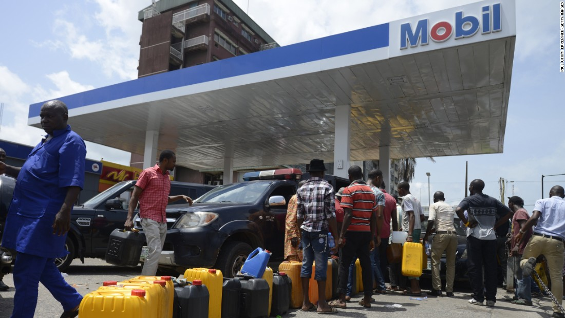 People lining up to buy fuel earlier this year at a Mobil gas station in Lagos, Nigeria. A fuel shortage has caused massive disruption for a country which relies on fuel for its cars but also for powering its generators.