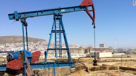 View of oil well and Baku