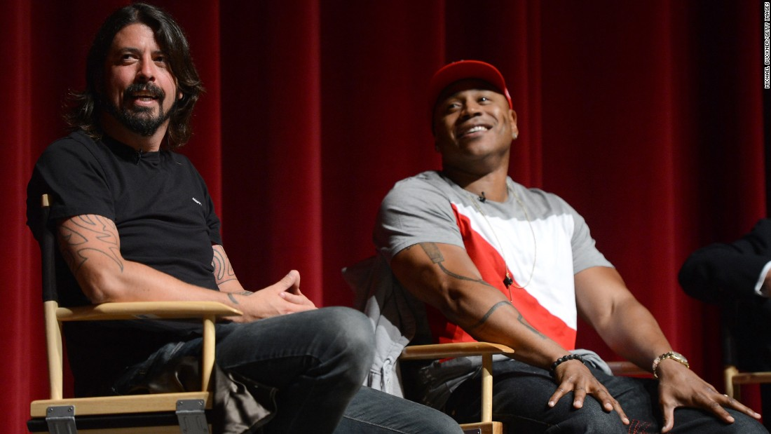 "Grohl and LL Cool J speak during the premiere of ""A Death In The Family: The Show Must Go On,"" a documentary about how the Grammys adjusted to Whitney Houston's death, in California in 2012."