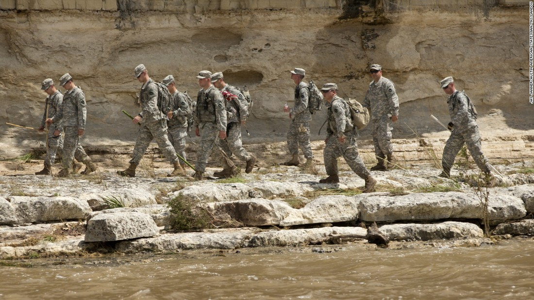 Members of the Texas National Guard search for bodies on the banks of the Blanco River after flooding in Wimberley on May 26.