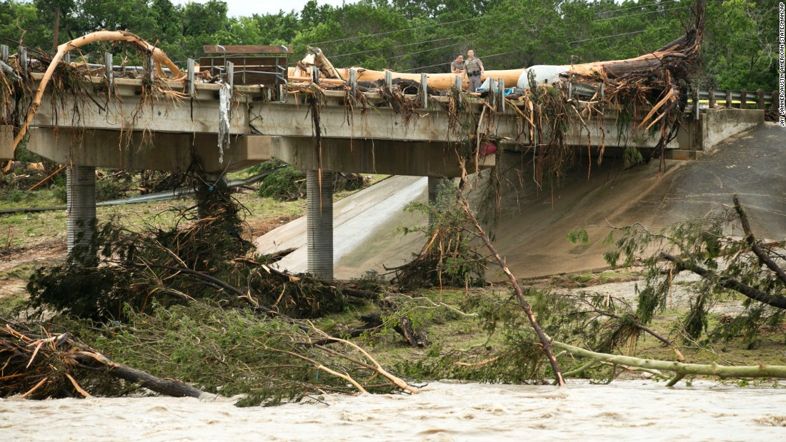 A large tree rests on the Highway 12 bridge over the Blanco River in Wimberley on May 24.