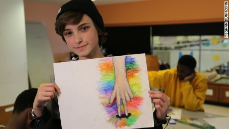 A student shows off his artwork created at one of the free ProjectArt classes in New York City.