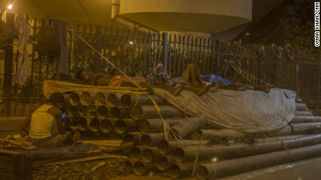 Construction workers asleep in the Delhi heat on May 27.