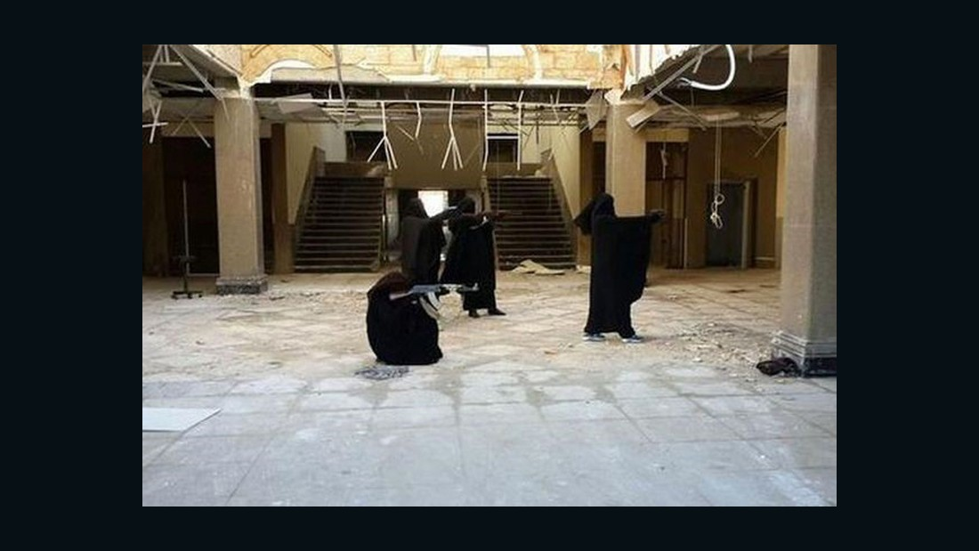 "ISD says Zahra Hallane also posted this photo of masked women practicing ""self-defence"". Photo supplied to CNN by ISD."