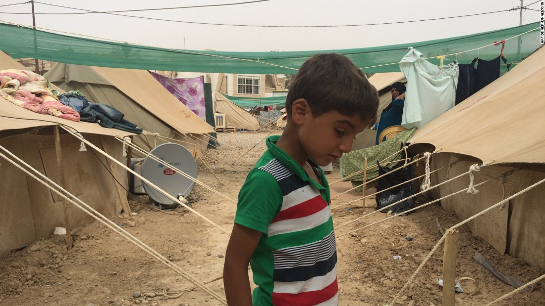 A boy stands between tents at a refugee camp in the al-Jamiaa neighborhood of Baghdad, Iraq, on Thursday, May 28. The camp houses people who have fled from ISIS-dominated Anbar province west of Baghdad.