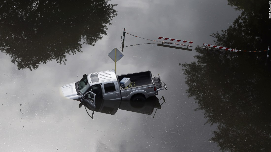 A truck is partially submerged in floodwaters near Houston's Bear Creek Park on May 30.