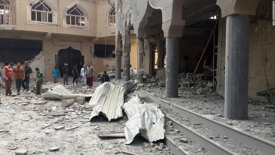 Residents examine a damaged mosque after an Iraqi Air Force bombing in the ISIS-seized city of Falluja, Iraq, on Sunday, May 31. At least six were killed and nine others wounded during the bombing.