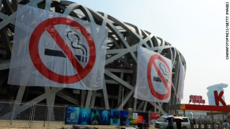 BEIJING, CHINA - MAY 30: (CHINA OUT) 'No Smoking' banners hang on the Bird's Nest on May 30, 2015 in Beijing, China. Beijing will launch new principles on 'No Smoking' on June 1 to control the smoking situation. It' said that Beijing airports, railway stations, passenger stations and bus stations will have no smoking rooms.